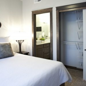 Bedroom and closet in model apartment